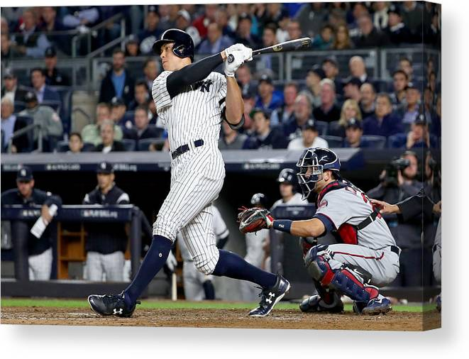 Playoffs Canvas Print featuring the photograph American League Wild Card Game - Minnesota Twins v New York Yankees by Al Bello