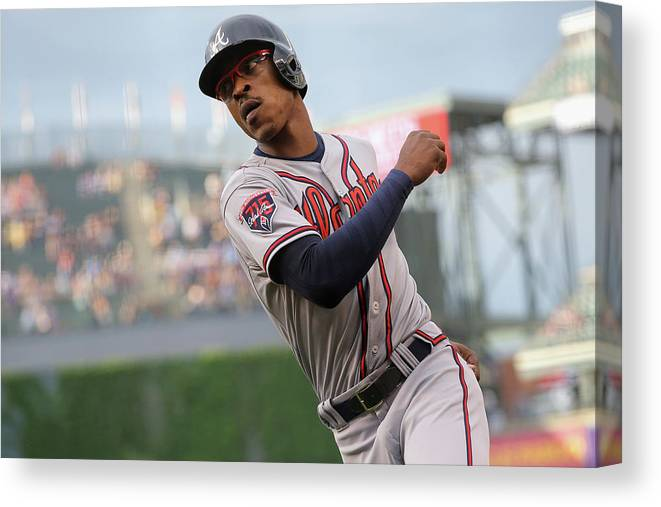 Scoring Canvas Print featuring the photograph Atlanta Braves V Colorado Rockies by Doug Pensinger