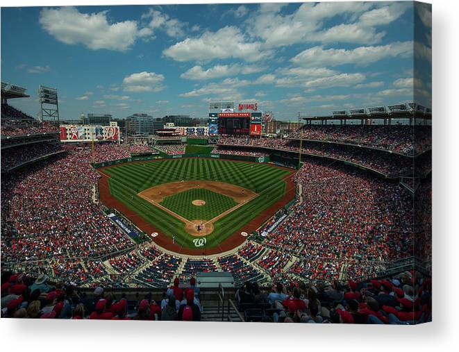 Motion Canvas Print featuring the photograph Atlanta Braves V. Washington Nationals by Rob Tringali