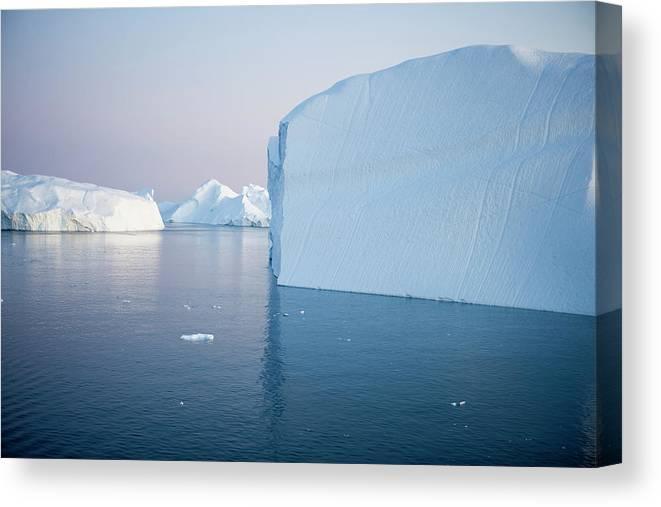 Melting Canvas Print featuring the photograph Icebergs Of Ilulissat Kangerlua by Holger Leue