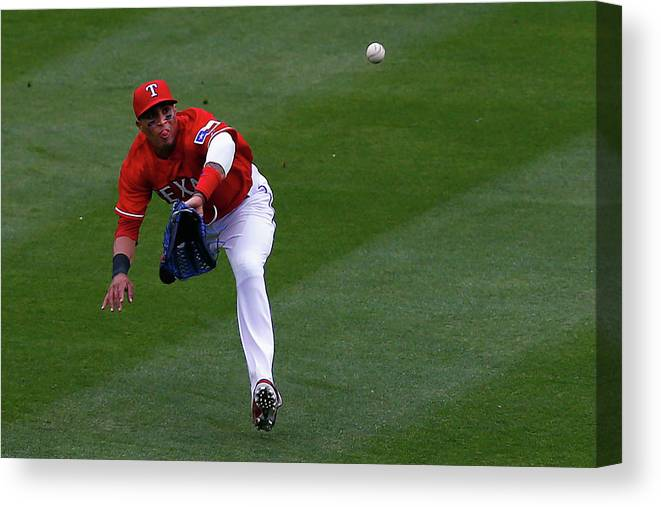 American League Baseball Canvas Print featuring the photograph Seattle Mariners V Texas Rangers by Tom Pennington