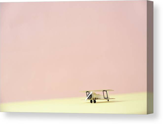 Shadow Canvas Print featuring the photograph The Model Of The Airplane Made Of The by Yagi Studio