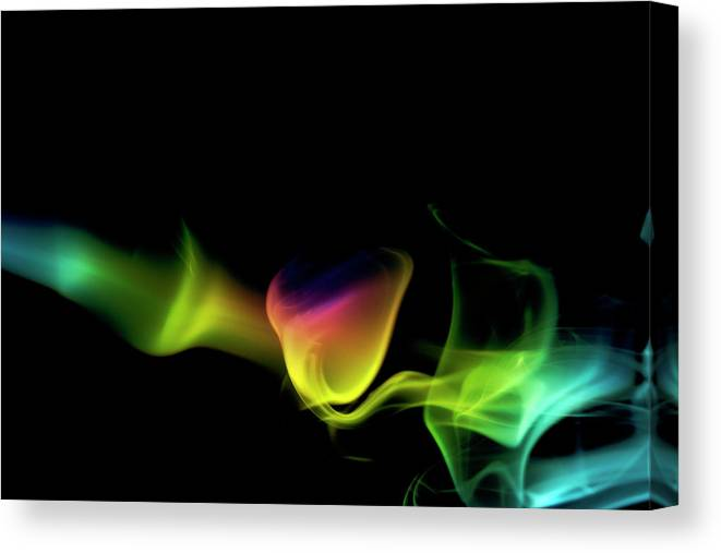 Black Background Canvas Print featuring the photograph Rainbow Smoke On A Black Background by Gm Stock Films
