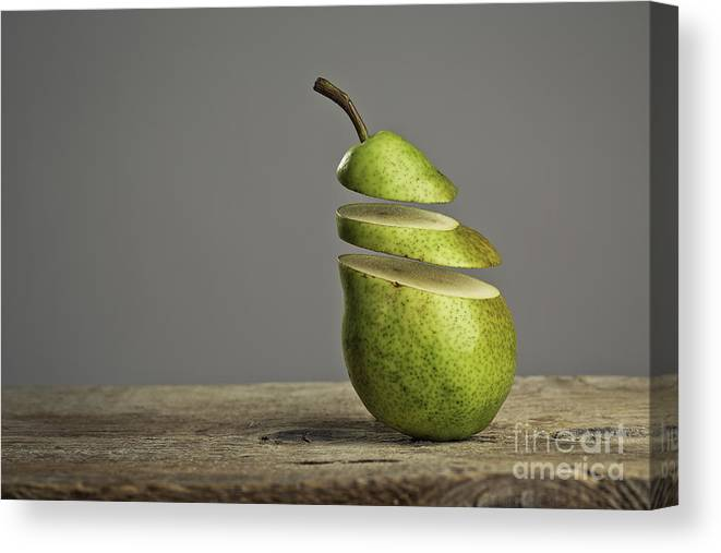 Pear Canvas Print featuring the photograph Sliced by Nailia Schwarz