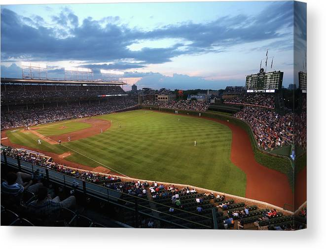National League Baseball Canvas Print featuring the photograph Cincinnati Reds V Chicago Cubs by Jonathan Daniel