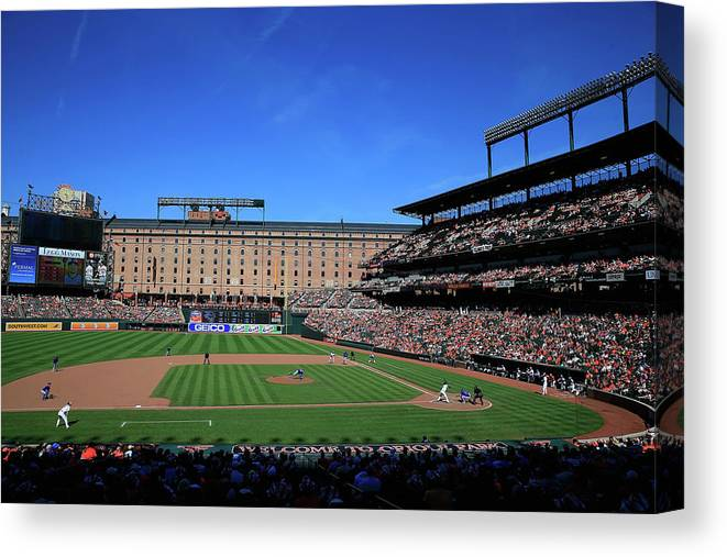 American League Baseball Canvas Print featuring the photograph Toronto Blue Jays V Baltimore Orioles by Rob Carr