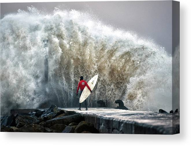 Professional Sport Canvas Print featuring the photograph A Pro-surfer Waits For A Break In The by Charles Mcquillan