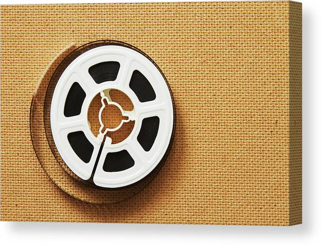 The Media Canvas Print featuring the photograph A Reel, Or Spool, Of 8mm Movie Film by Jon Schulte