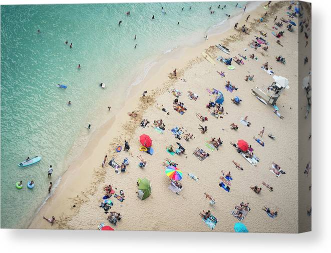 Honolulu Canvas Print featuring the photograph Aerial View Of Tourists On Beach by Alberto Guglielmi