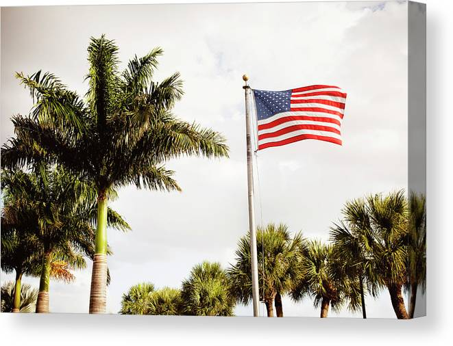 Tranquility Canvas Print featuring the photograph American Flag Flying Amongst Palm Trees by Ron Levine