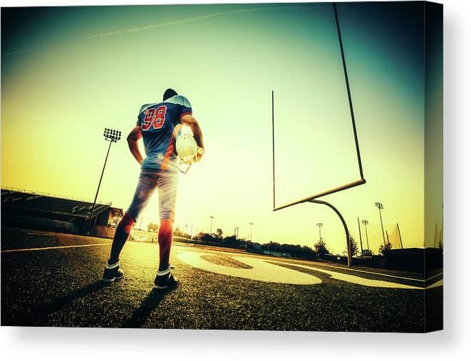 Headwear Canvas Print featuring the photograph American Football Player by Ferrantraite