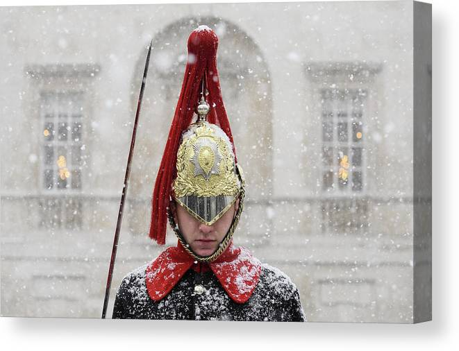 Snow Canvas Print featuring the photograph Britain Freezes As Siberian Weather by Leon Neal