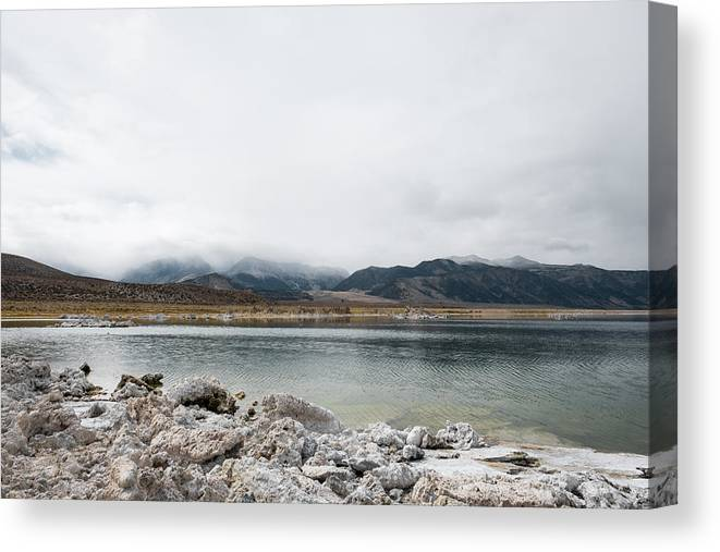 Tranquility Canvas Print featuring the photograph Calm Lake Against Mountain Range by Christian Soldatke / EyeEm