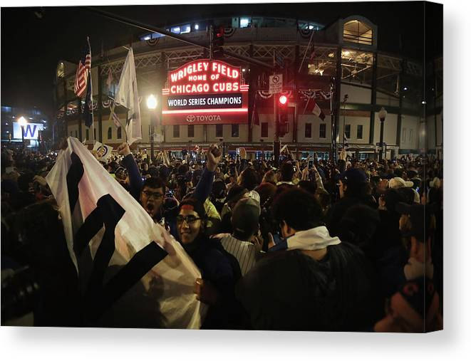 American League Baseball Canvas Print featuring the photograph Chicago Cubs Fans Gather To Watch Game by Scott Olson