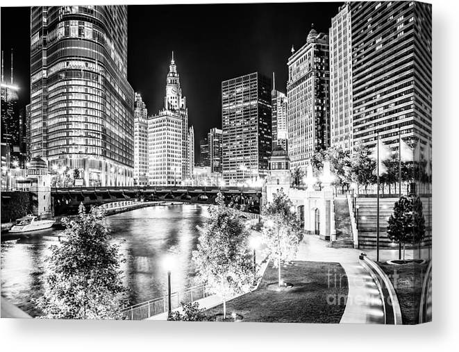 America Canvas Print featuring the photograph Chicago River Buildings at Night in Black and White by Paul Velgos