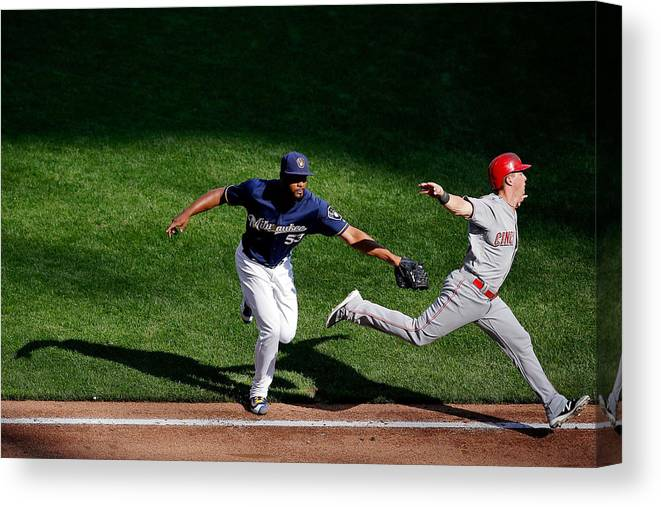 American League Baseball Canvas Print featuring the photograph Cincinnati Reds V Milwaukee Brewers by Jon Durr