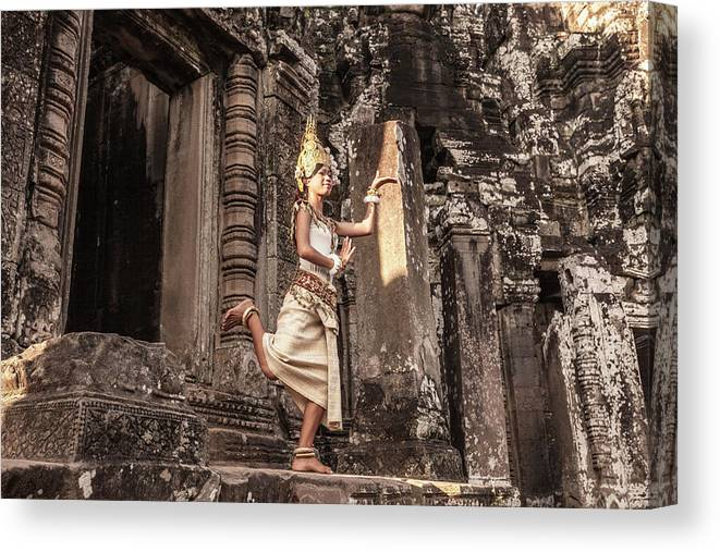 Hinduism Canvas Print featuring the photograph Female Apsara Dancer, Standing On One by Cultura Exclusive/gary Latham