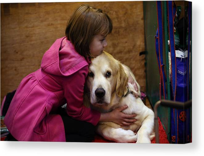 Child Canvas Print featuring the photograph First Day Of Crufts 2015 by Carl Court
