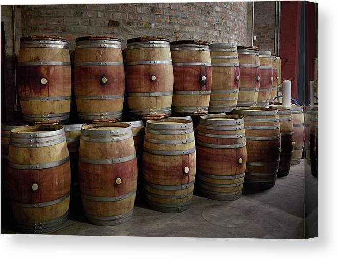Stellenbosch Canvas Print featuring the photograph French Wine Barrels Stacked At Winery by Klaus Vedfelt