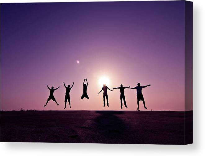 Human Arm Canvas Print featuring the photograph Friends Jumping Against Sunset by Kazi Sudipto Photography