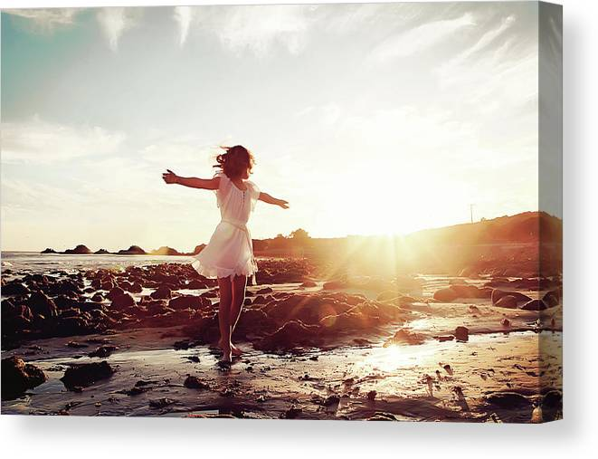 Human Arm Canvas Print featuring the photograph Girl Dancing On Beach At Sunset Sun Rays by Dianne Avery Photography