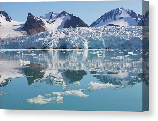Scenics Canvas Print featuring the photograph Glaciers Tumble Into The Sea In The by Anna Henly