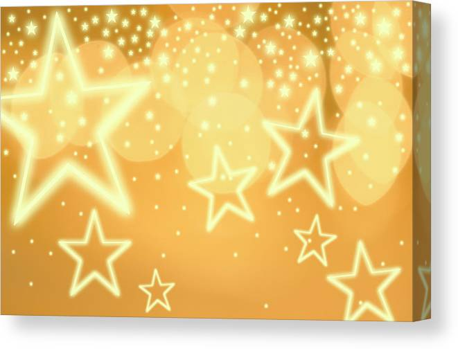 Christmas Lights Canvas Print featuring the photograph Glowing Background With Stars, Studio by Tetra Images