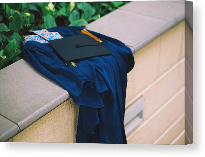 Education Canvas Print featuring the photograph Graduation Gown With Mortarboard On Retaining Wall by Danial Najmi / EyeEm