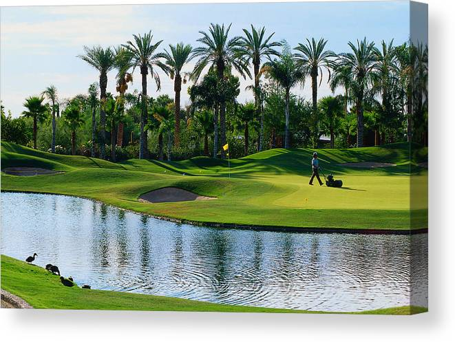 Working Canvas Print featuring the photograph Greens-keeper Tending Golf Course by John Hay