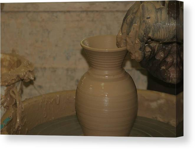 Pottery Canvas Print featuring the photograph Hands of the Potter by Dervent Wiltshire