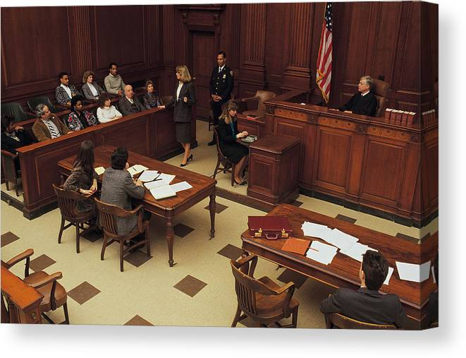 Crowd Canvas Print featuring the photograph High angle view of courtroom by Comstock
