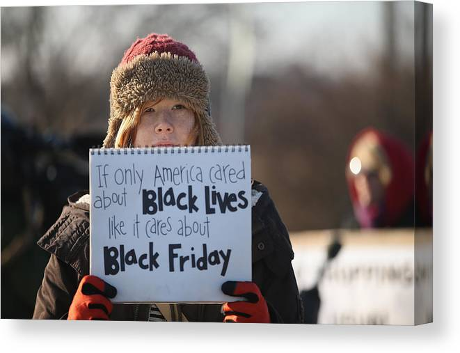 Justice Canvas Print featuring the photograph Holiday Shopping Begins In Ferguson As Protests Continue by Scott Olson