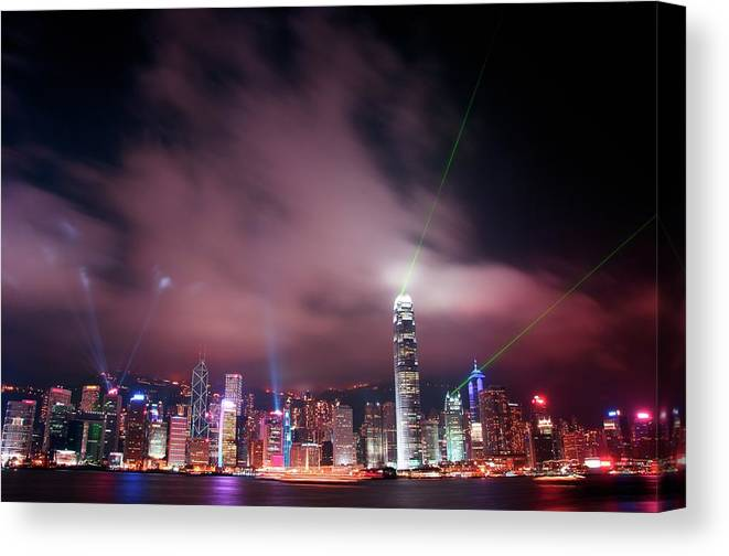 Tranquility Canvas Print featuring the photograph Hong Kong Laser Lights by Photo By Dan Goldberger