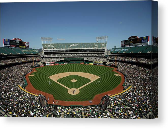 American League Baseball Canvas Print featuring the photograph Houston Astros V Oakland Athletics by Ezra Shaw