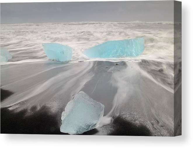 Scenics Canvas Print featuring the photograph Icebergs Washed Up On Volcanic Sandy by Travelpix Ltd