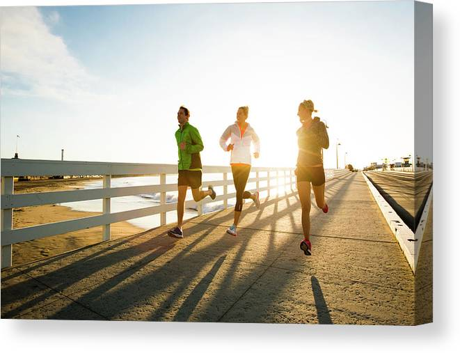 Young Men Canvas Print featuring the photograph Jogging Along The Coast by Jordan Siemens