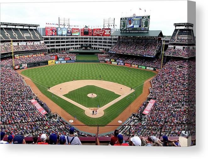 American League Baseball Canvas Print featuring the photograph Kansas City Royals V Texas Rangers by Rick Yeatts
