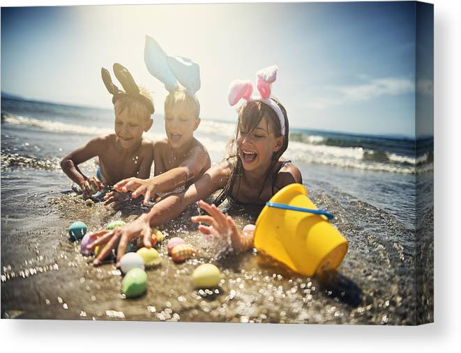 Easter Bunny Canvas Print featuring the photograph Kids playing in sea during summer Easter by Imgorthand