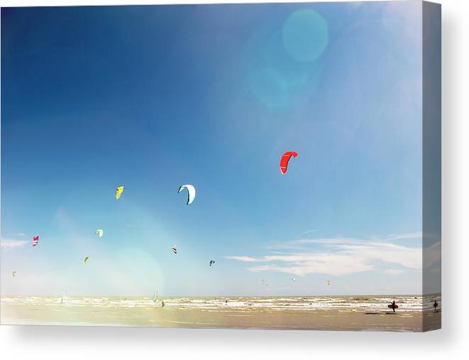 Water's Edge Canvas Print featuring the photograph Kite Surfers by Nick David