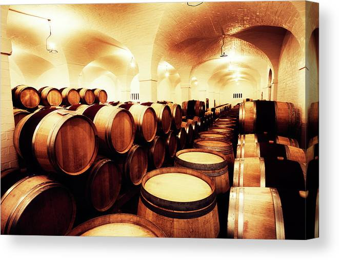 Alcohol Canvas Print featuring the photograph Large Winery Cellar Filled With Oak by Rapideye