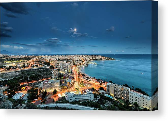 Built Structure Canvas Print featuring the photograph Lights In The City by Photographer Of The World