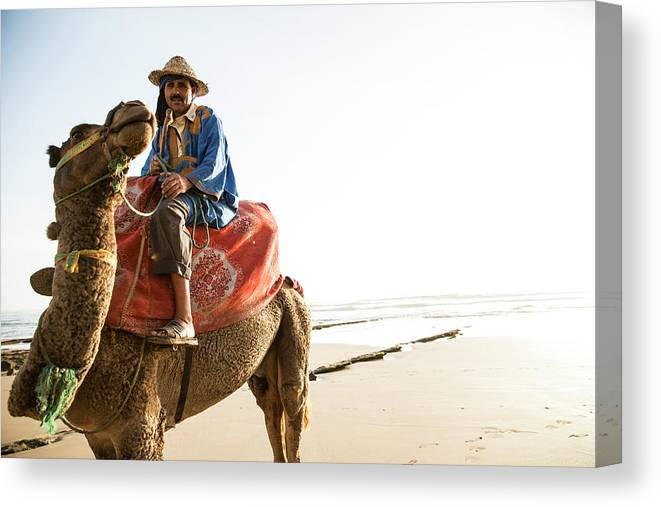 Agadir Canvas Print featuring the photograph Man On Camel On Beach, Taghazout by Tim E White