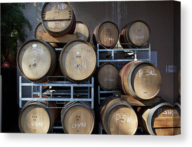 Stellenbosch Canvas Print featuring the photograph Multible Wooden French Winebarrels On by Klaus Vedfelt