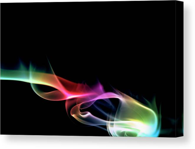 Black Background Canvas Print featuring the photograph Multicolored Smoke On A Black Background by Gm Stock Films