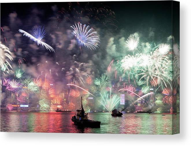 Firework Display Canvas Print featuring the photograph New Year Fireworks Hong Kong Asia by Steffen Schnur