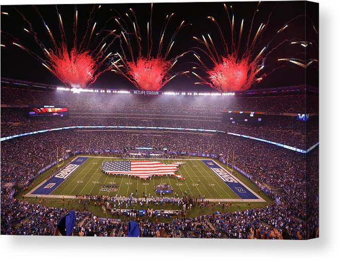 Firework Display Canvas Print featuring the photograph Nfl Sep 18 Lions At Giants by Icon Sportswire