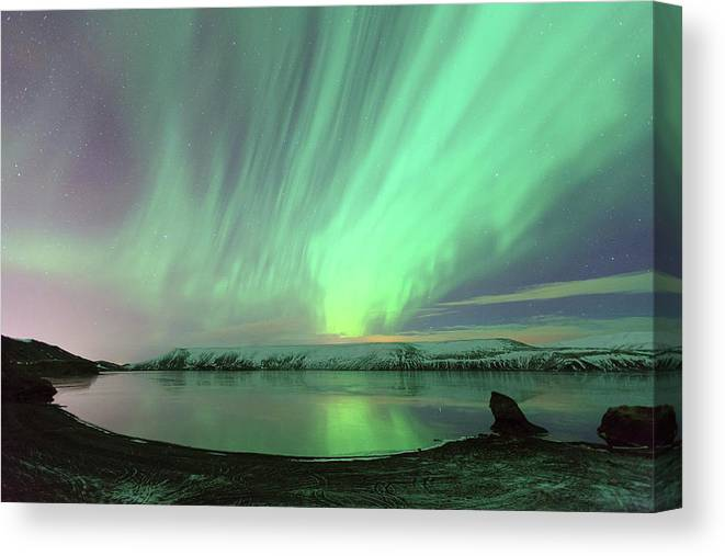 Scenics Canvas Print featuring the photograph Northern Lights In Iceland by By Chakarin Wattanamongkol
