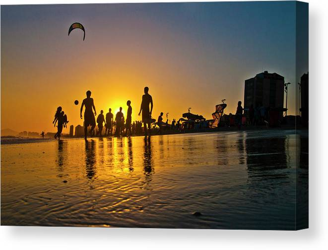 Parachuting Canvas Print featuring the photograph People Having Fun In The Beach by Giovani Cordioli