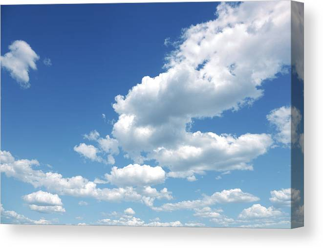Scenics Canvas Print featuring the photograph Photo of some white whispy clouds and blue sky cloudscape by Kertlis