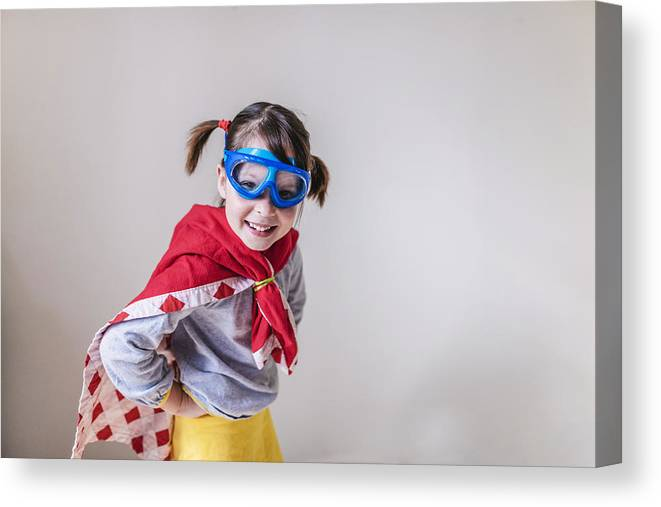 4-5 Years Canvas Print featuring the photograph Portrait of a smiling girl dressed as a superhero by Elizabethsalleebauer